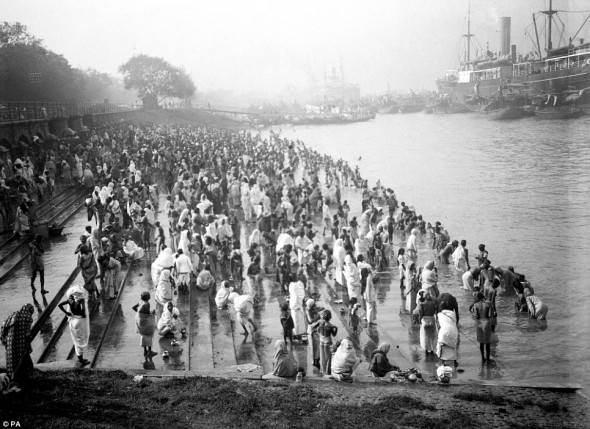 A crowded riverside with bathers at Chandpal Ghat in Calcutta