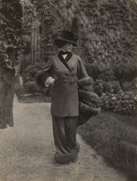 Walking ensemble of fur-trimmed jacket with belt