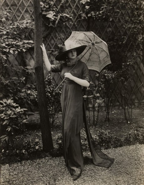 Model Dolores carrying a parasol and posing in a Directoire