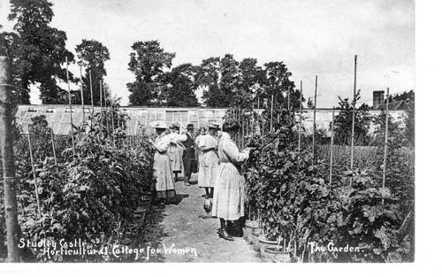 Tutor and students in garden. 1910